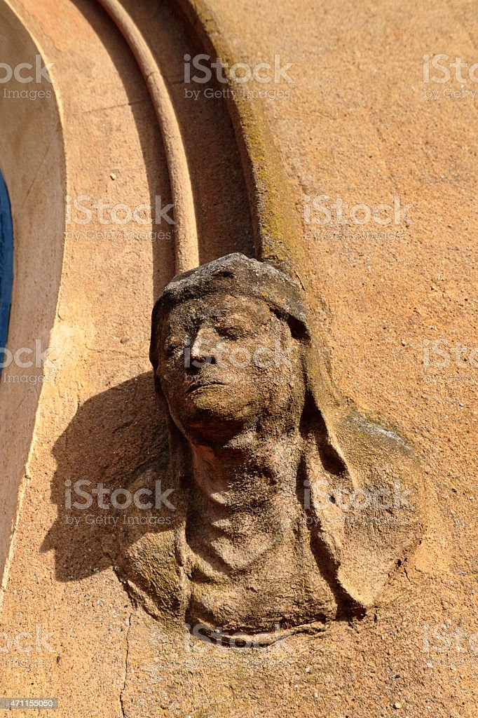 Stone gargoyle at entrance to Mitcham parish church England stock photo