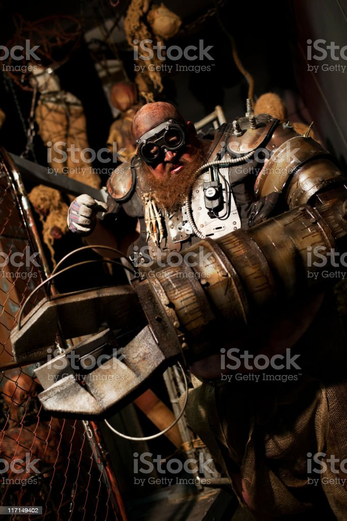 Cyborg Monster with Mechanical Arm Costume in Haunted House stock photo
