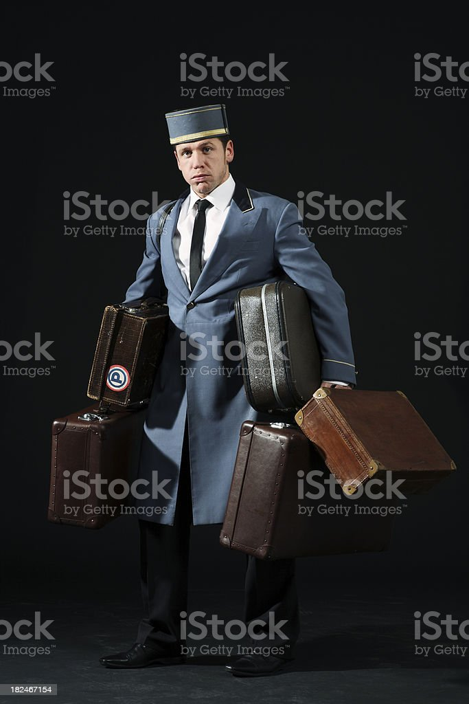 this is heavy! bellboy stock photo