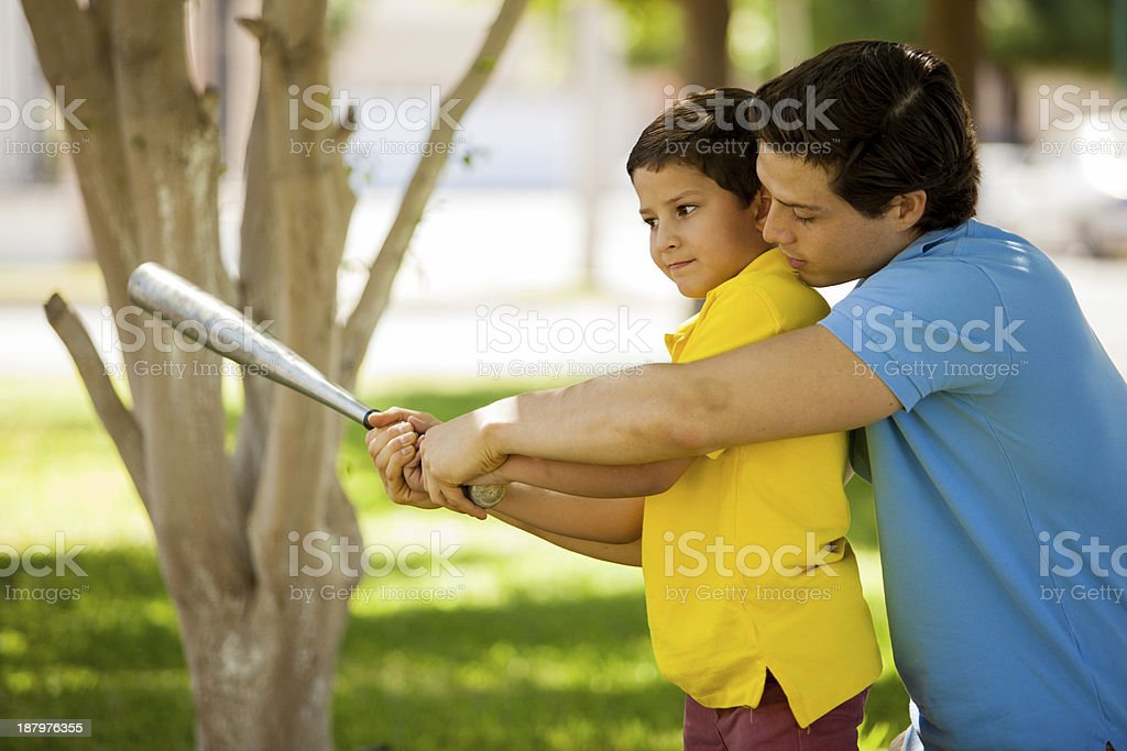 This is how you swing a bat stock photo