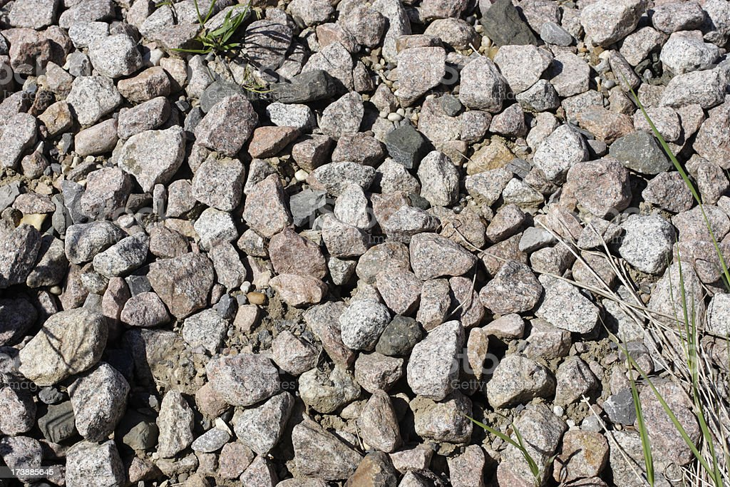 Granite aggregate stone chippings dumped on waste ground royalty-free stock photo
