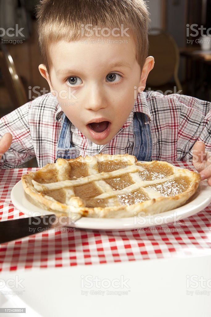 This kid loves sugar pie royalty-free stock photo