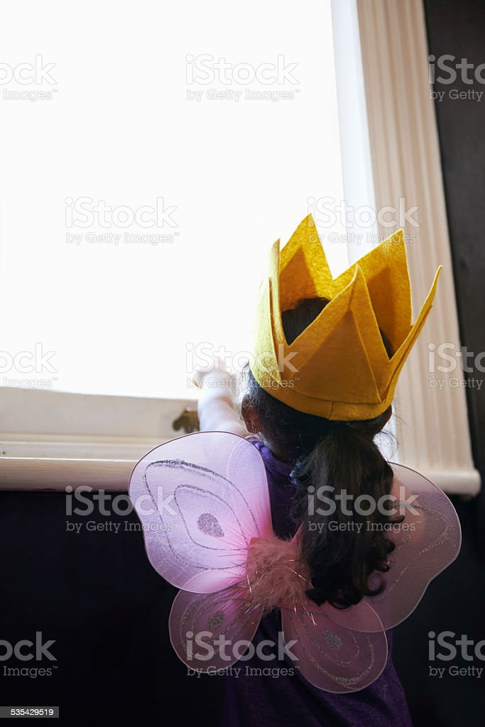 This little fairy's got her sights set on the stars! stock photo