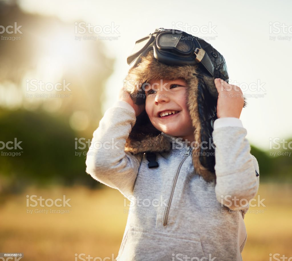 This little lad has big dreams stock photo