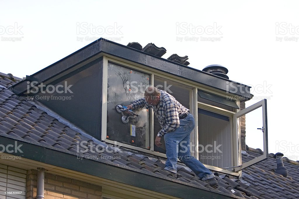This man puts in a new window royalty-free stock photo