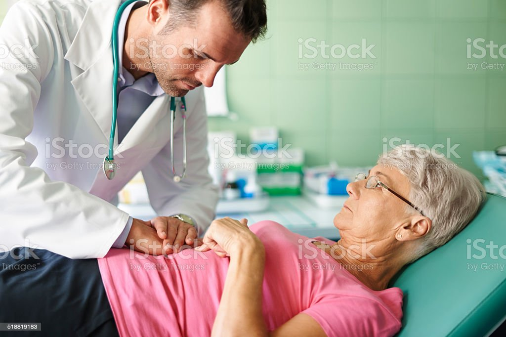 This pain of stomach is unbearable stock photo