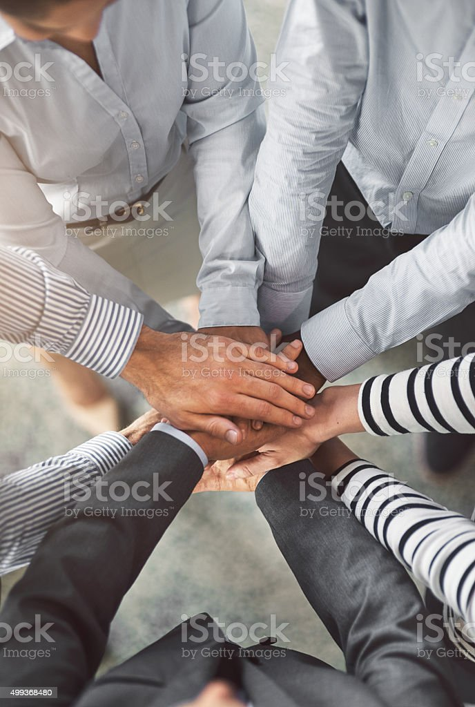 This team goes all in! stock photo