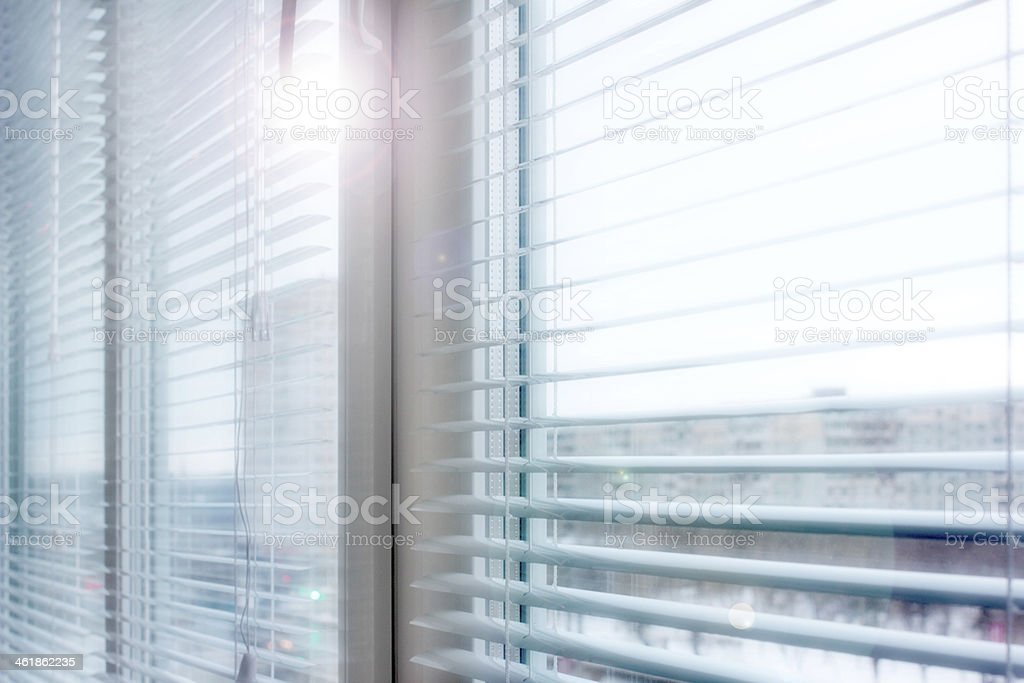 This window has plastic shutters to use as blinds  stock photo
