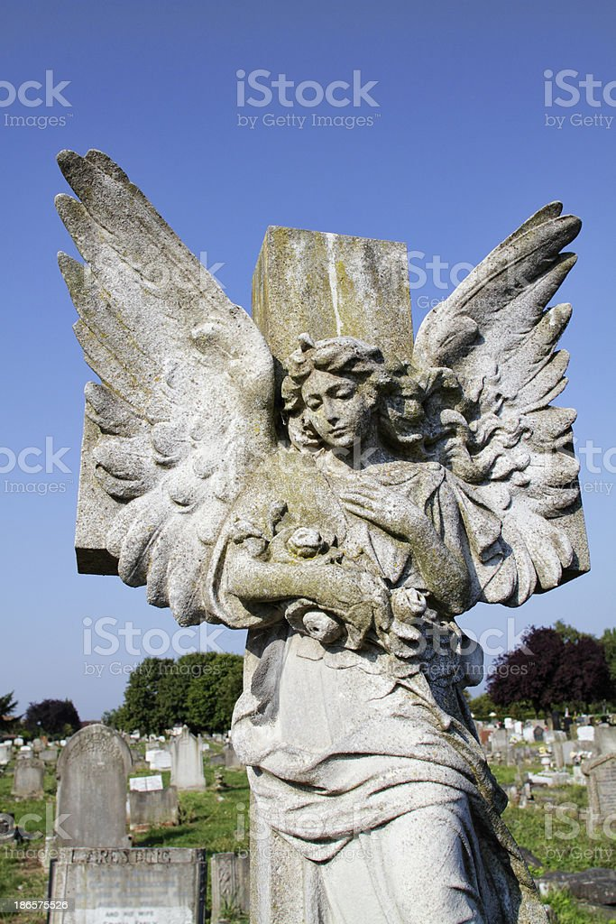 Winged angel on cross with roses royalty-free stock photo