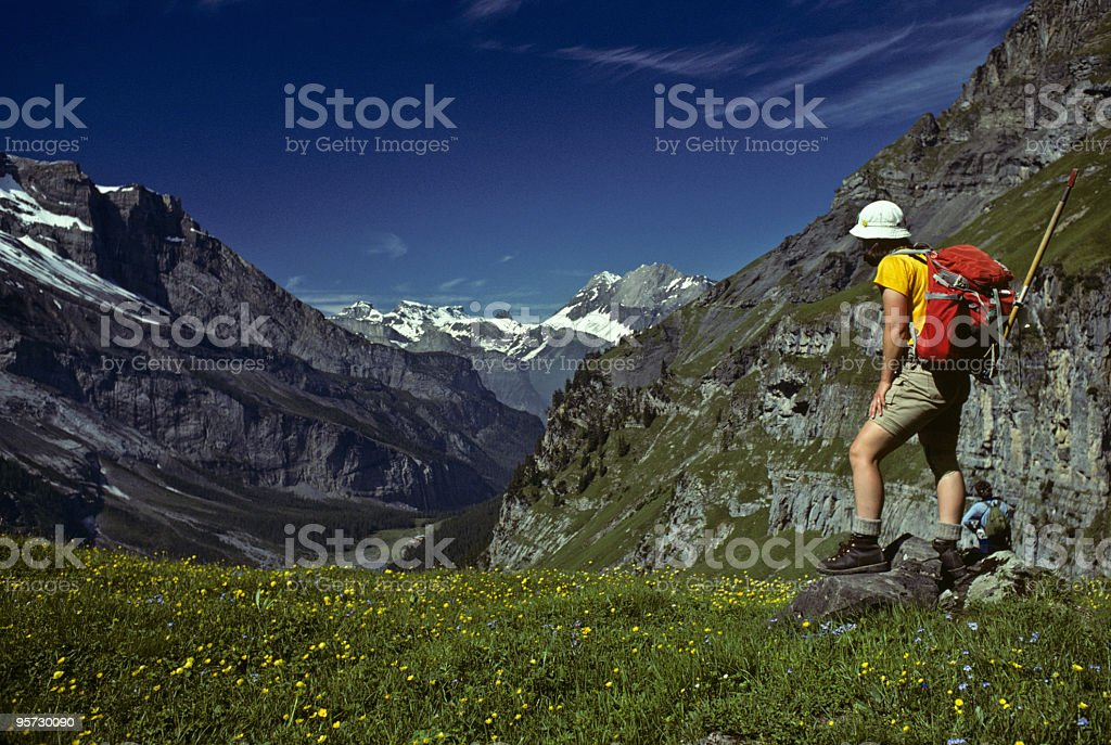 Young Woman Hiking in the Swiss Alps royalty-free stock photo