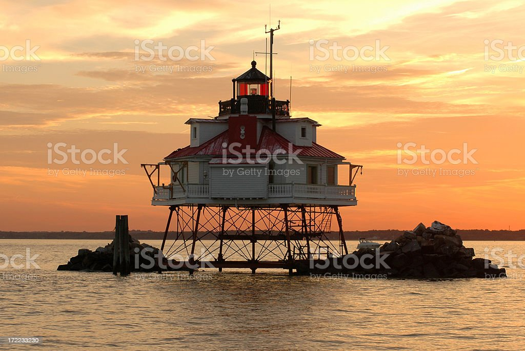 Thomas point lighthouse during a colorful sunset stock photo