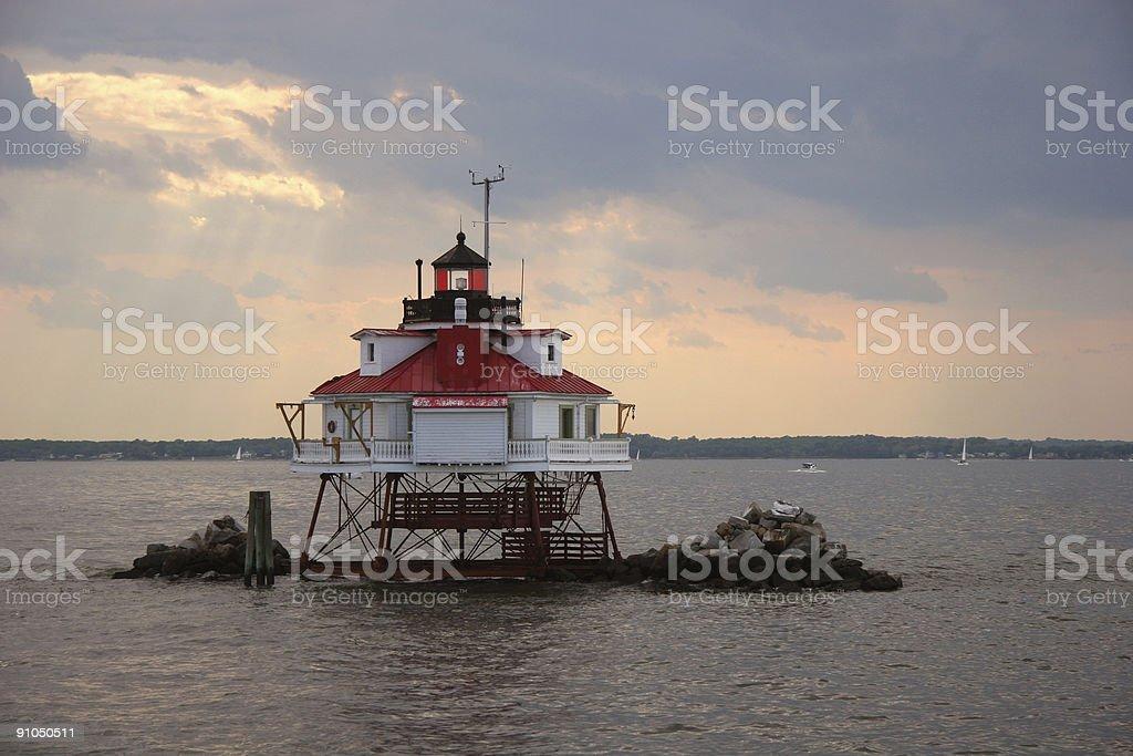 Thomas point lighthouse under dramatic sky closeup stock photo