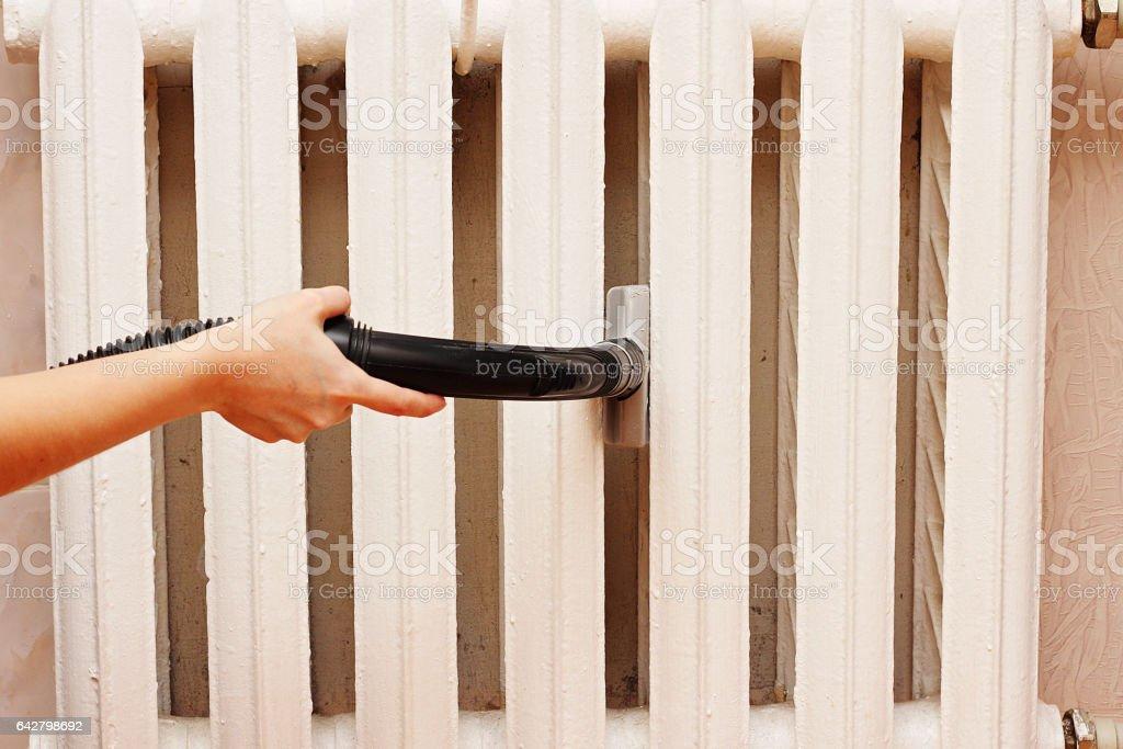 Thorough vacuuming radiator. stock photo