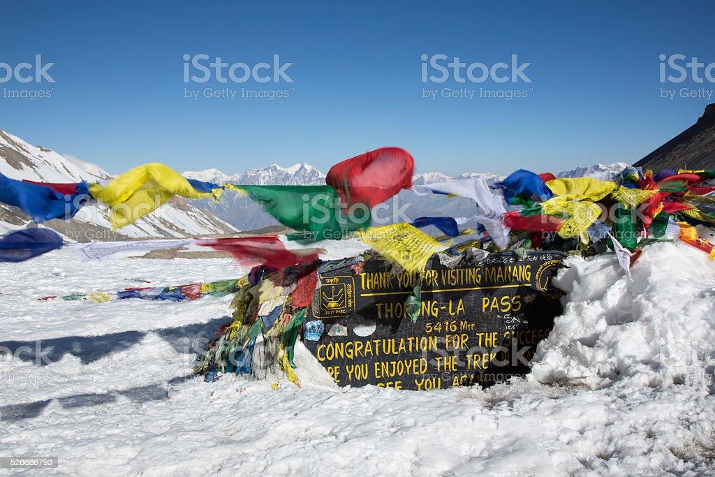 Thorung La Pass and Tibetan Prayer Flags, Annapurna, Nepal stock photo