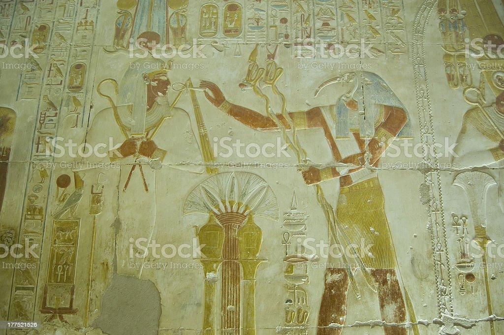 Thoth praising Osiris bas relief stock photo