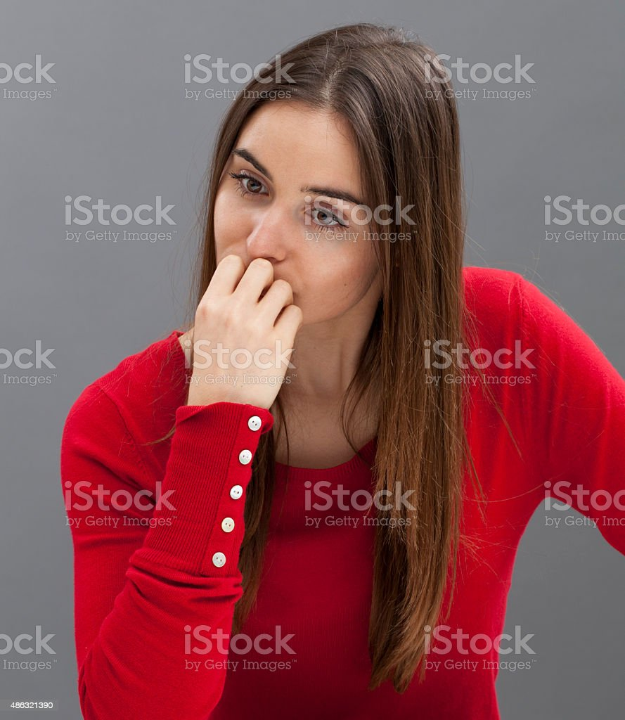 thoughtful 20s woman looking sad and concerned stock photo