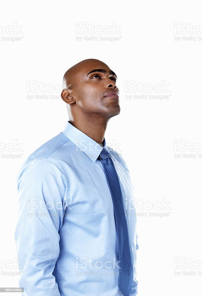 Thoughtful African American business man against white royalty-free stock photo