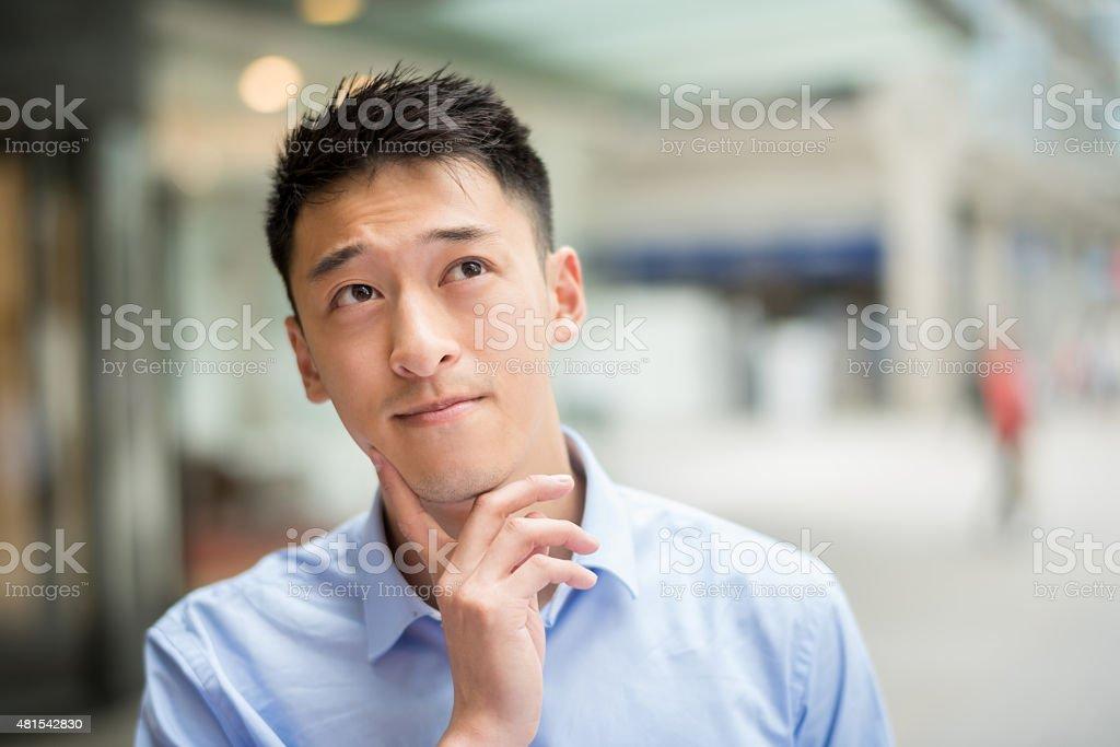 Thoughtful Asian business man stock photo