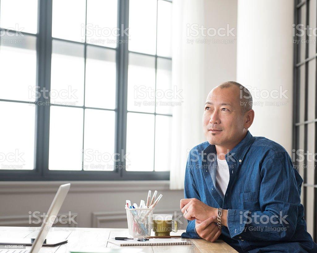 Thoughtful Asian man stock photo