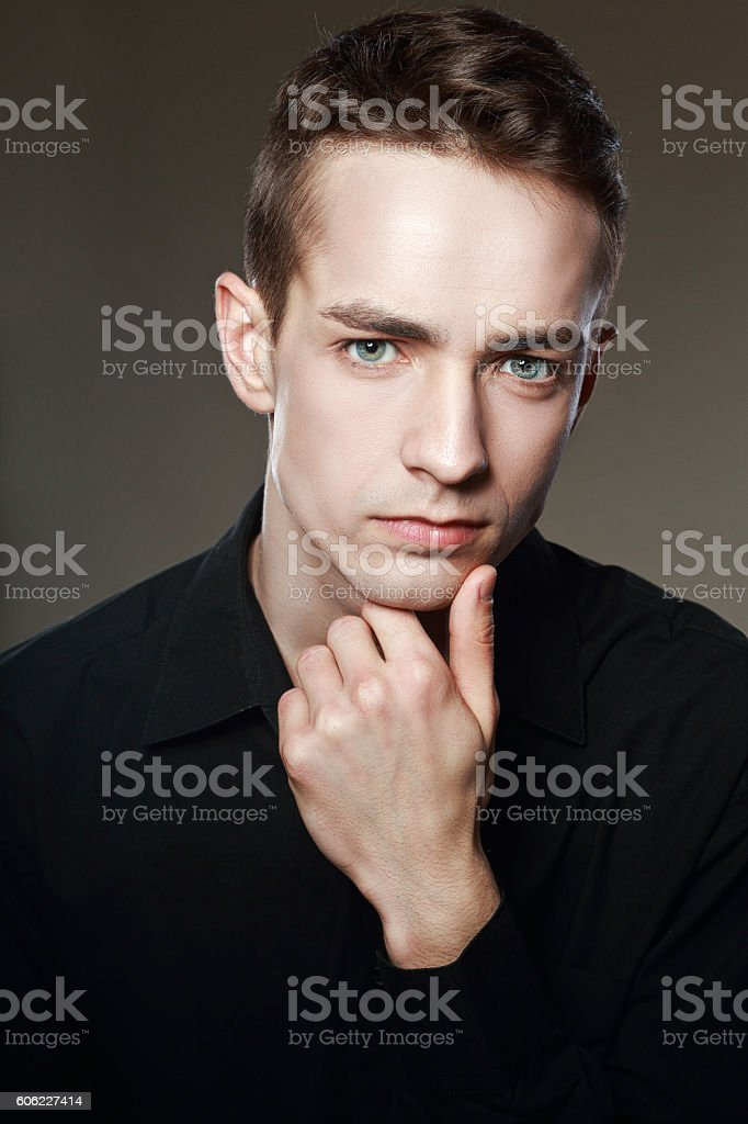 thoughtful attracttive man stock photo