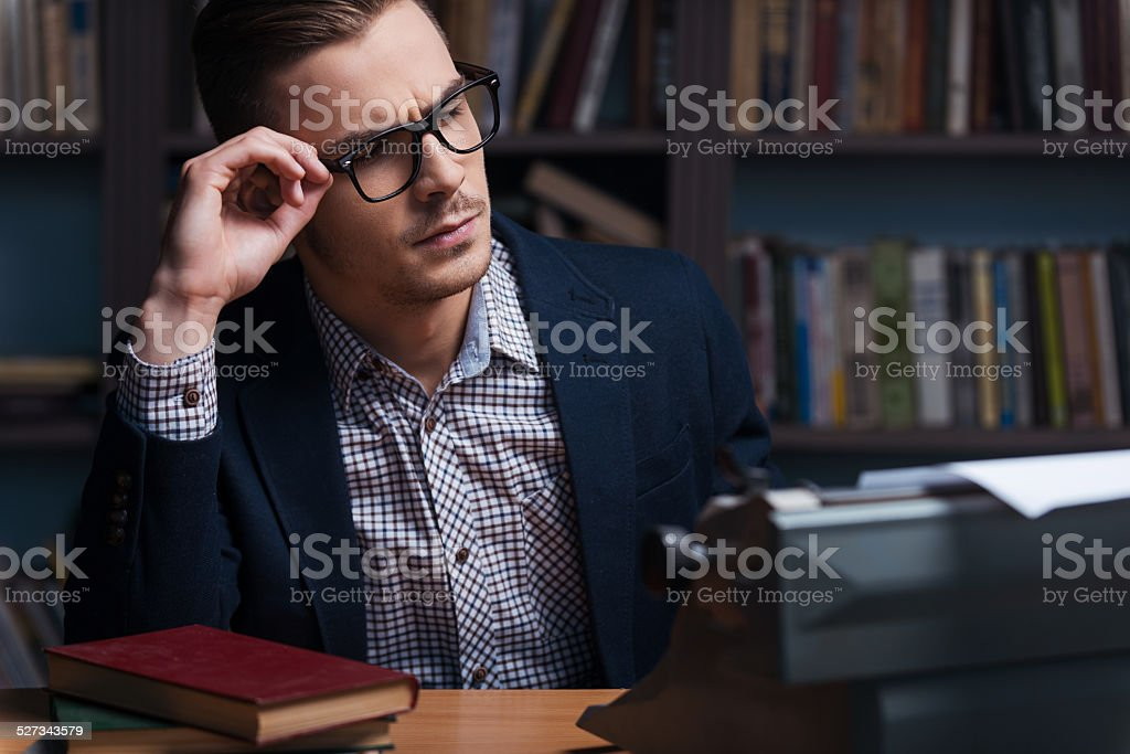 Thoughtful author. stock photo