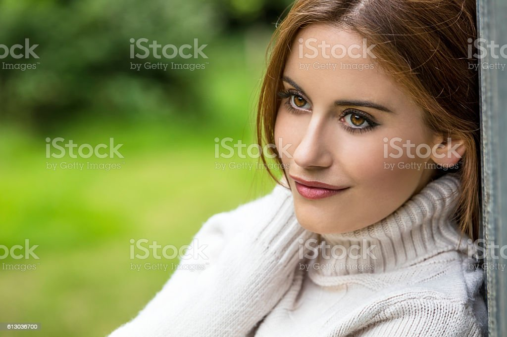 Thoughtful Beautiful Young Woman With Red Hair stock photo