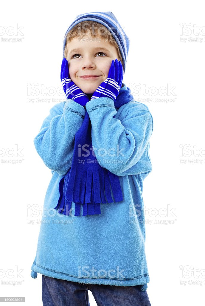 Thoughtful boy in winter clothes royalty-free stock photo