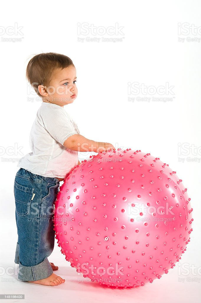 Thoughtful boy with pink ball royalty-free stock photo