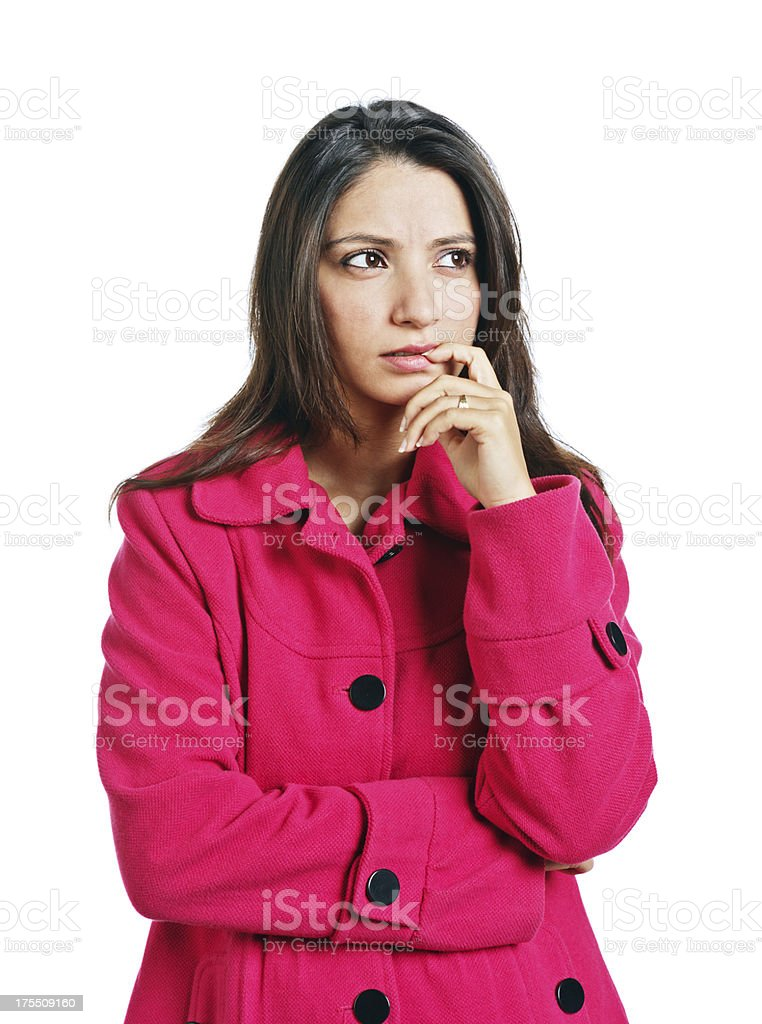Thoughtful brunette looking sideways, finger to mouth royalty-free stock photo