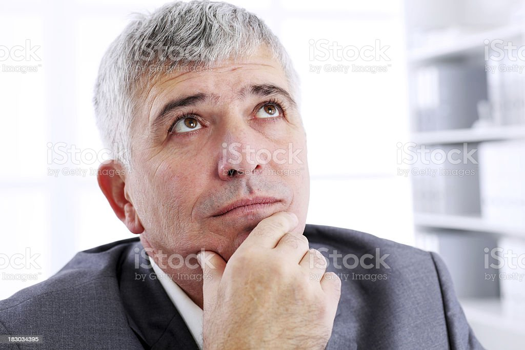 Thoughtful business man at workplace. royalty-free stock photo