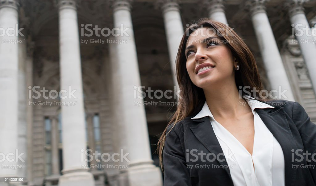 Thoughtful business woman outdoors stock photo