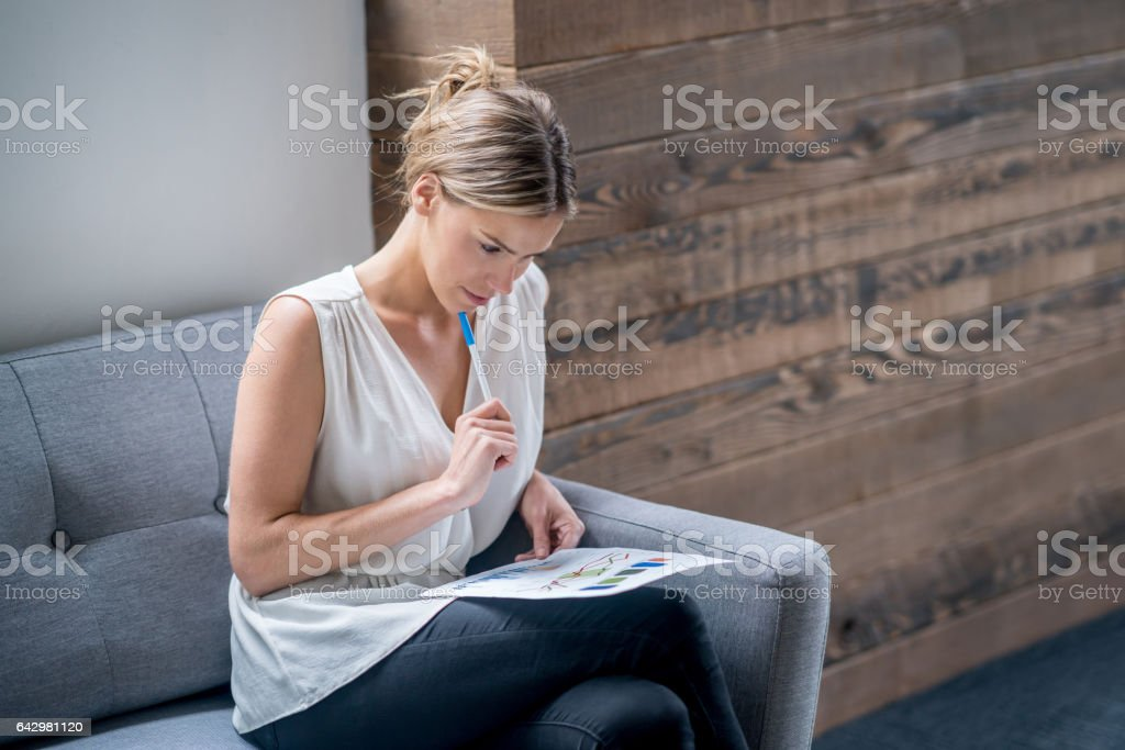 Thoughtful business woman working at the office stock photo