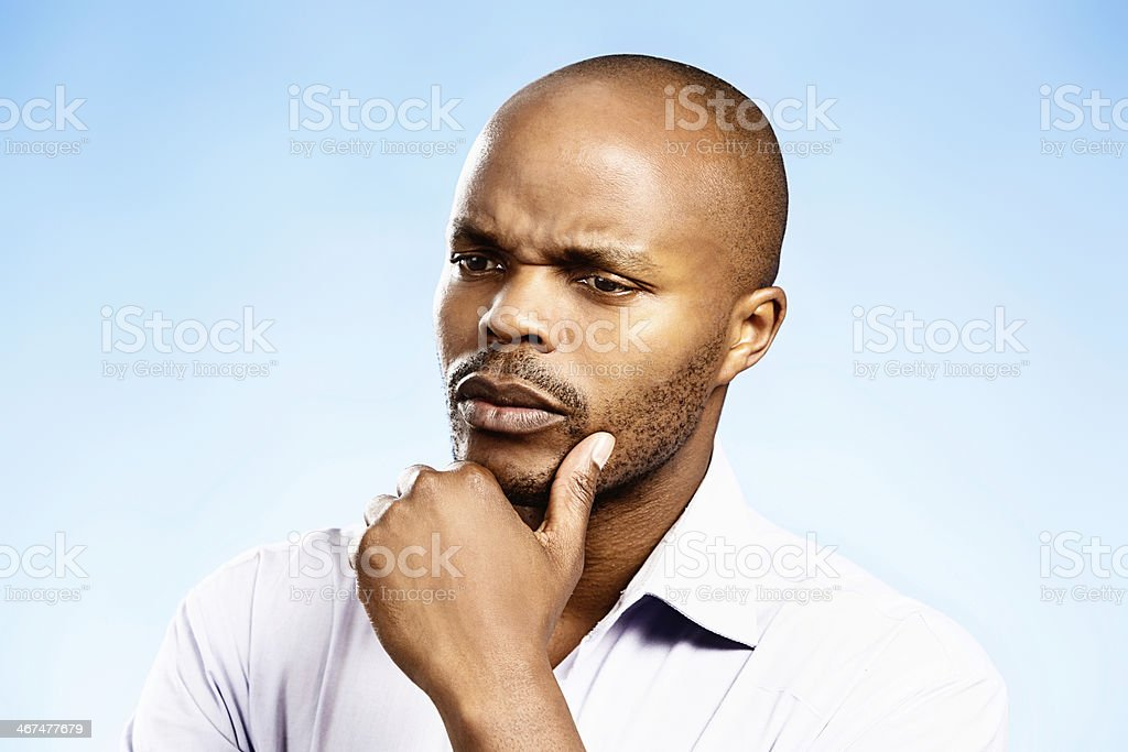 Thoughtful businessman considers his options seriously royalty-free stock photo
