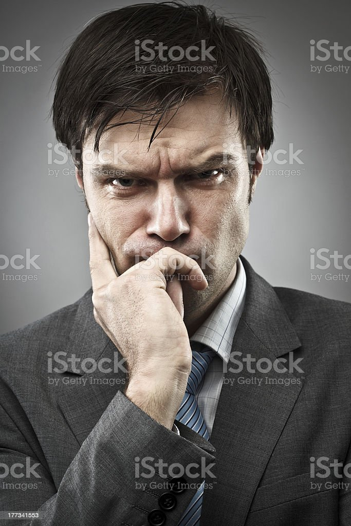Thoughtful businessman stock photo
