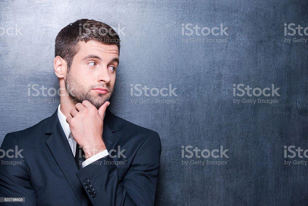 Thoughtful businessman. stock photo