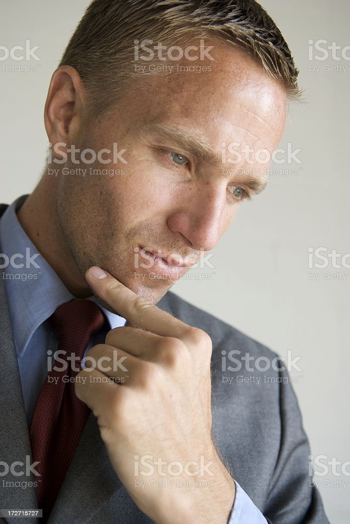 Thoughtful Businessman Thinking with Hand on Chin Close Up royalty-free stock photo