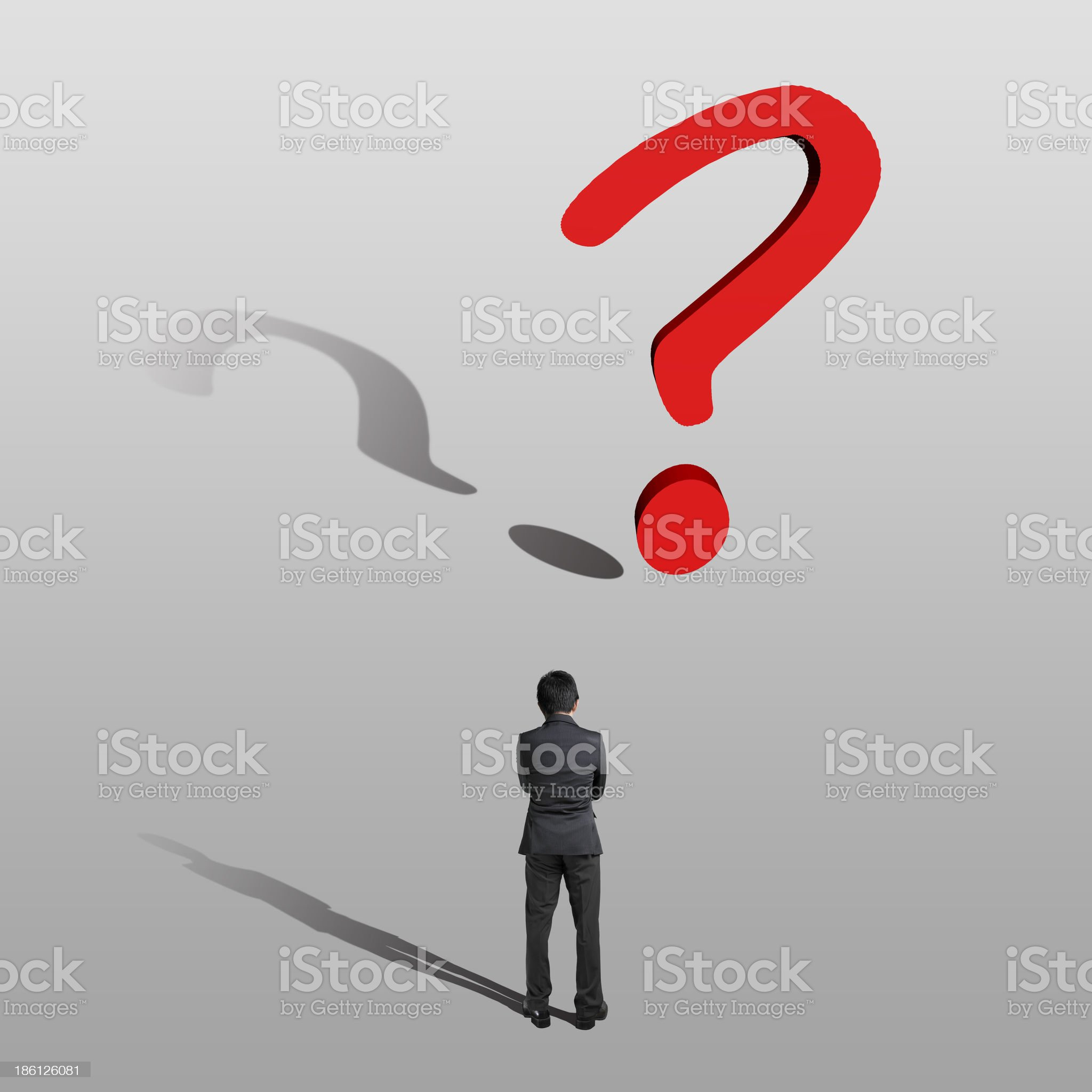 Thoughtful businessman with a big question mark royalty-free stock photo