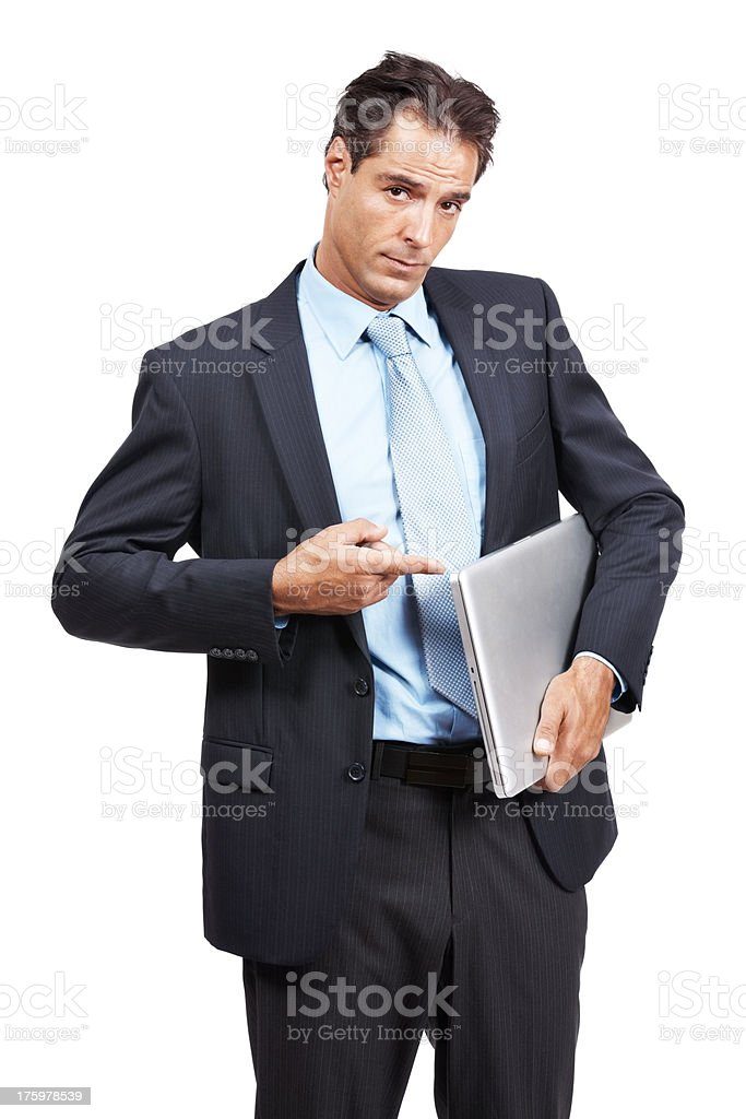 Thoughtful businessman with a laptop pointing at side isolated on white stock photo