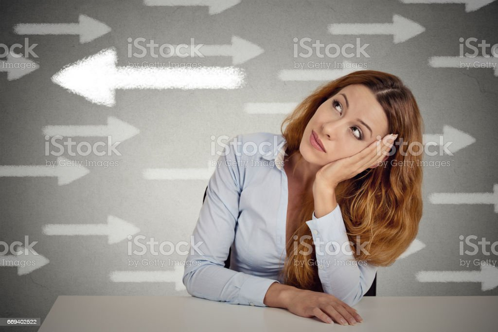 Thoughtful businesswoman sitting at table stock photo