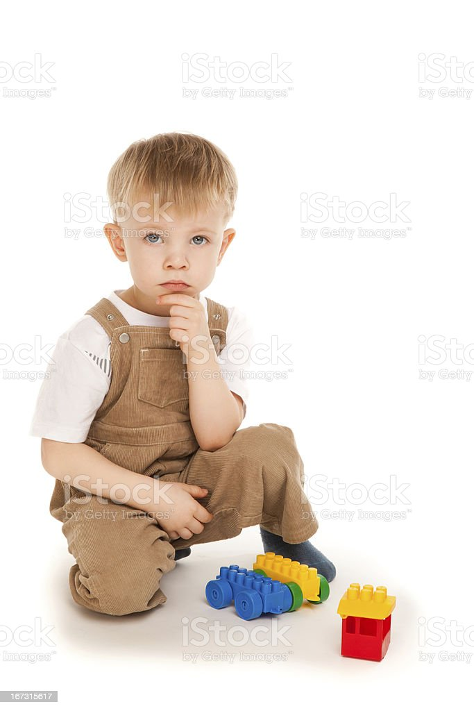 Thoughtful child playing with toys isolated royalty-free stock photo