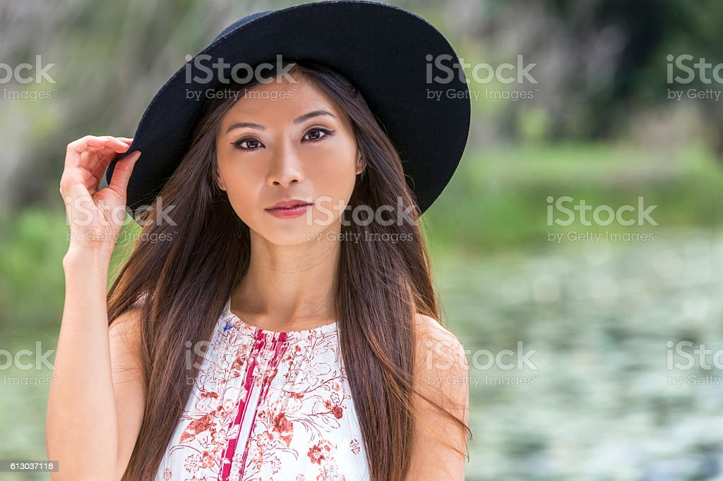 Thoughtful Chinese Asian Young Woman Girl Wearing Black Hat stock photo