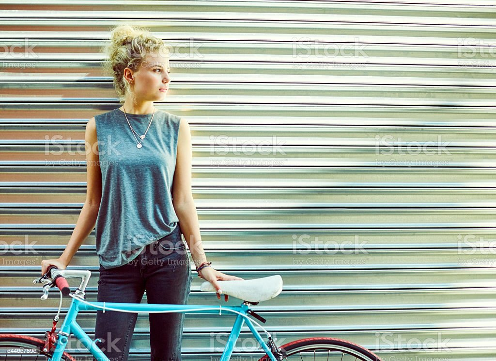 Thoughtful commuter with bicycle against shutter stock photo