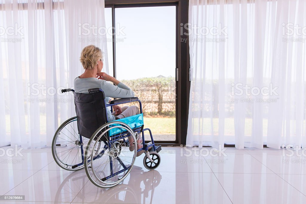 thoughtful disabled woman in wheelchair stock photo