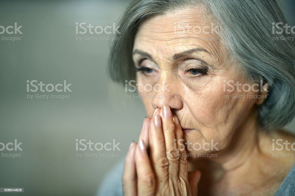 Thoughtful elderly woman stock photo