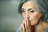 Thoughtful elderly woman