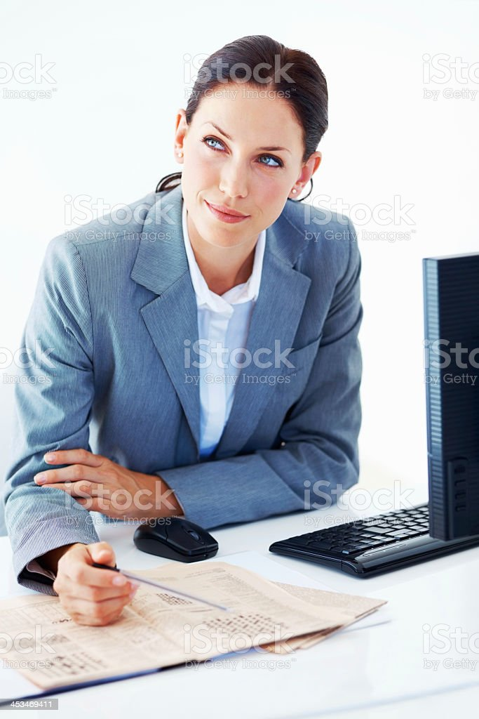 Thoughtful executive solving puzzle stock photo