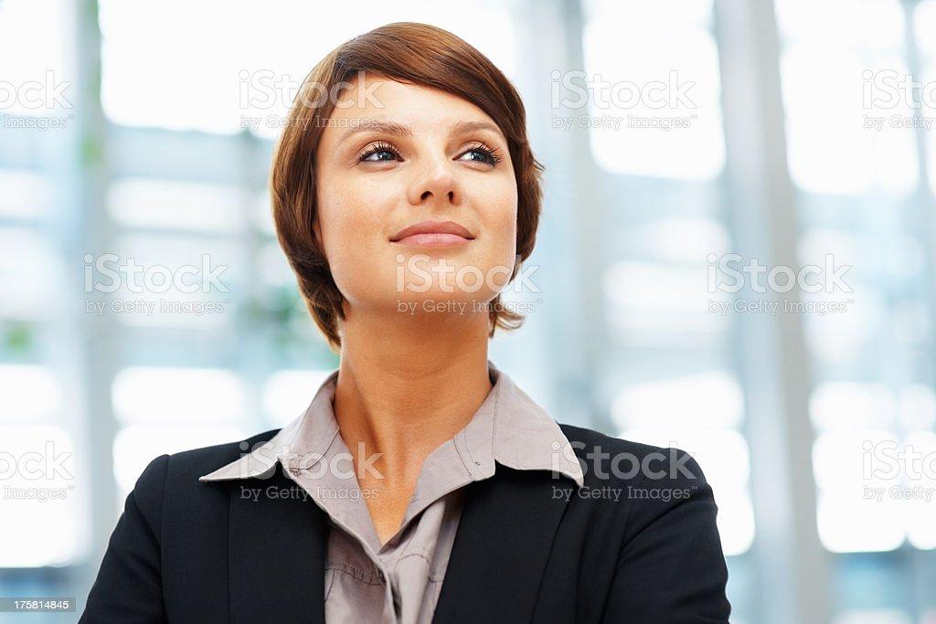 Thoughtful female executive stock photo