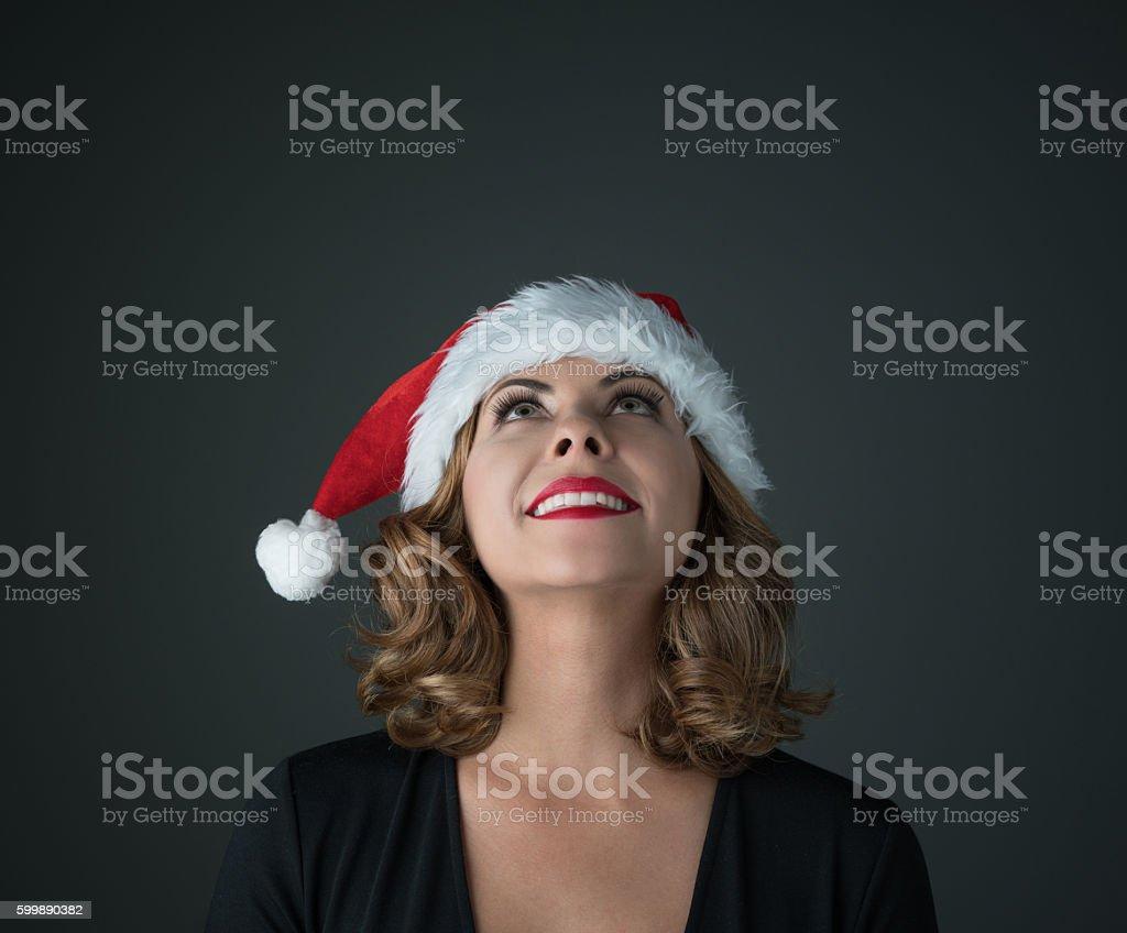 Thoughtful female Santa stock photo