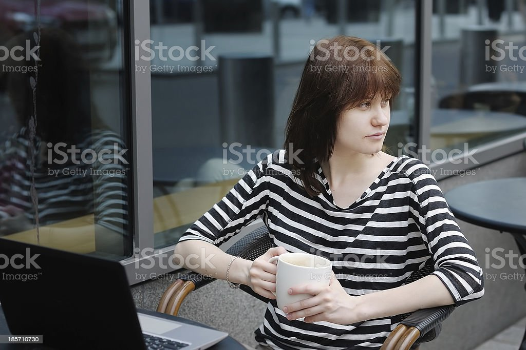 Thoughtful girl in a outdoor cafe royalty-free stock photo