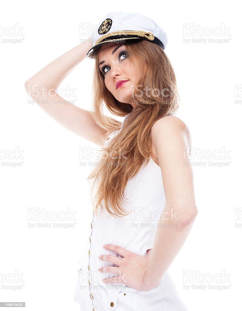 Thoughtful girl posing in cap on white background stock photo